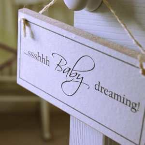hanging baby dreaming sign with Shhh baby dreaming on a nursery door