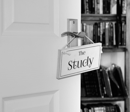 monochrome wood sign on door with the study