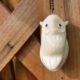 fair trade tagua nut owl necklace hanging on wood