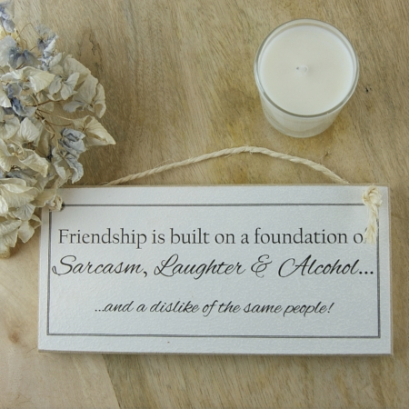 friendship quote sign with candle and hyacinth home of juniper