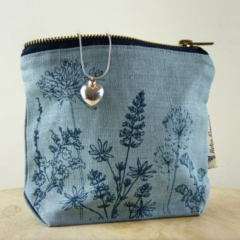linen make up bag by helen round in cowslip blue with heart necklace - home of juniper