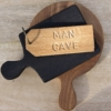 man cave keyring on wood boards home of juniper