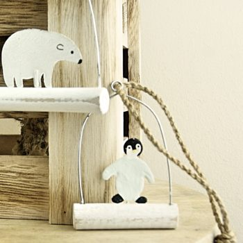penguin and polar bear hanging decoration on wood table