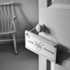 black and white baby dreaming sign on door