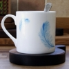 bone china mug on wood board coaster - home of juniper
