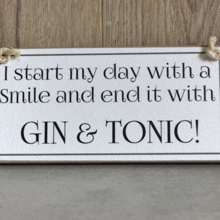 I start my day with a smile and end it with a gin and tonic sign