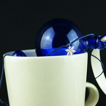 Blue bauble in a mug and wish bracelet
