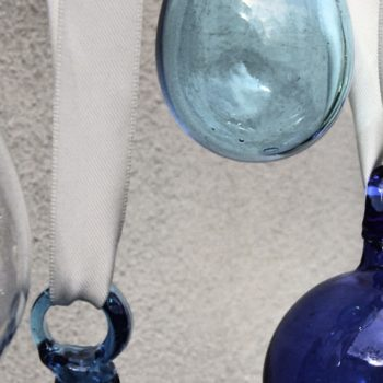 fair trade glass baubles selection of blue and clear baubles