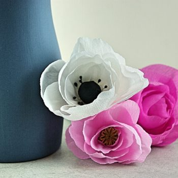 Paper anemone, and roses with vase
