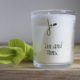 gin and tonic fragrance candle by home of juniper next to paperbea foliage