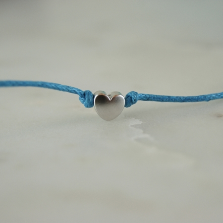 silver plated heart wish bracelet on light blue cotton cord home of juniper