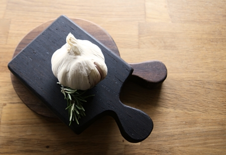 small square wood board with garlic on handmade by rosie brewer
