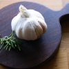 small round wood board with garlic on handmade by rosie brewer