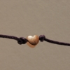 rose gold heart charm wish bracelet on purple cotton cord home of juniper