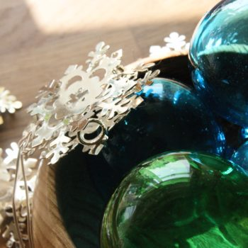 mix of glass fair-trade glass baubles blue and green with snowflake lights home of juniper