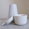 white earternware vase, tea-bowl and tea-strainer by sue pryke for home of juniper