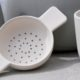 Tea bowl and tea-strainer in Stone by Sue Pryke for La Juniper