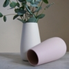 white and pink sue pryke vases with eucalyptus