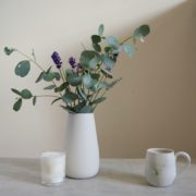 white earternware vase, tea-bowl and tea-strainer by sue pryke for home of juniper with eucalyptus