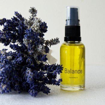 balance natural face oil on lavender.