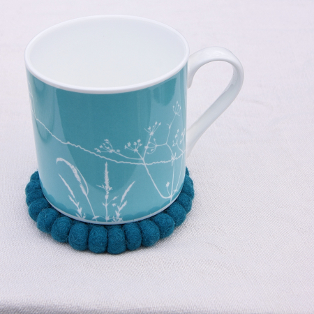 Hedgerow-mug-helen-round-on-felt-coaster