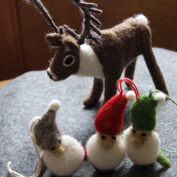 deer felt decoration on grey lambswool blanket with felt santa