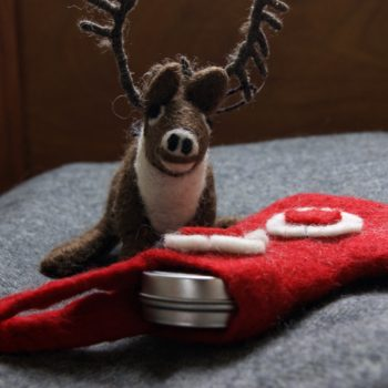 felt stag and red stocking with lip balm in stocking