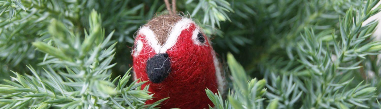 mini felt robin decoration hanging in a juniper tree