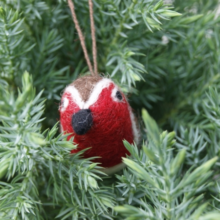 mini felt robin decoration hanging in a juniper tree