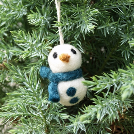 felt snowman christmas decoration in tree with blue scarf and buttons
