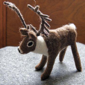 deer felt decoration on grey lambswool blanket