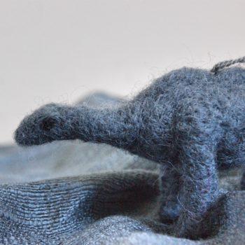 grey felt dinosaur decoration