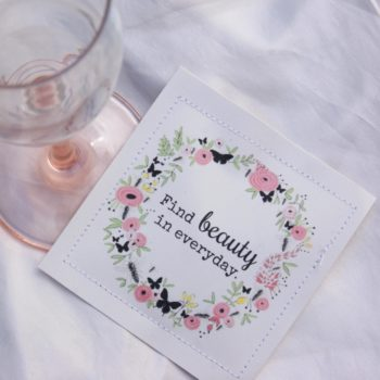 wildflower seeds with the quote find beauty in the everyday near wine glass