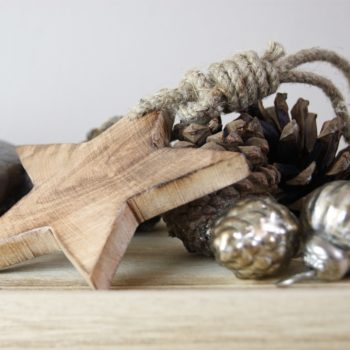 wood hanging star on mini baubles and fir cones