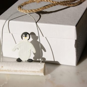 hanging arctic penguin decoration and white gift box home of juniper