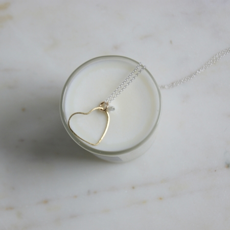wire-brass-heart-necklace-on-top-of-a-candle-homeofjuniper