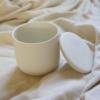 open-white-lidded-earthenware-pot