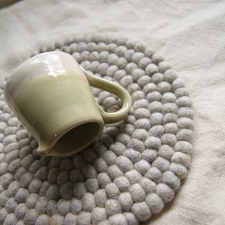 banner-green-ceramic-jug-neutral-woolplacemat