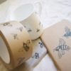 bee-mug-snack-bag-brown-tape-notebook