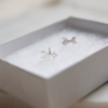 banner-silver-arrow-studs-boxed