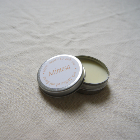 metal tin lip balm with mimosa on the label