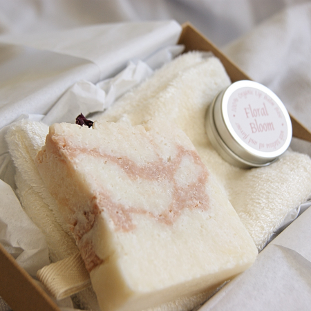 open gift set with lip balm luxury soap and bamboo shower mitt