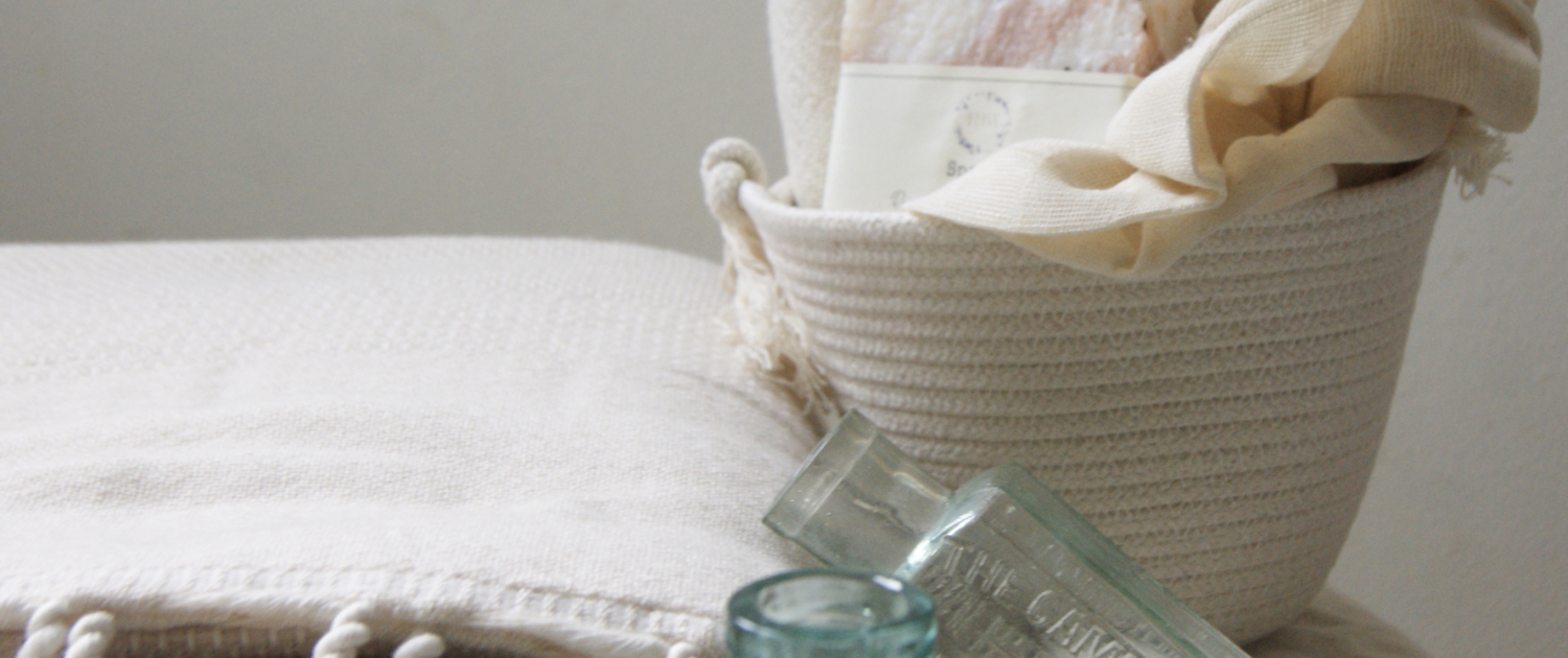 selection of plastic free items including a spa bar and bath puff in a cotton planter
