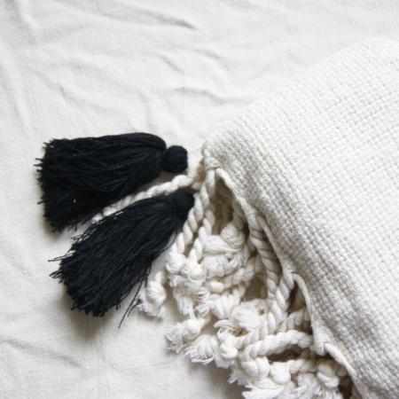 Ecru-throw-with-black-tassels