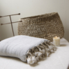 grey wool cotton throw basket candle and brass jewellery stand